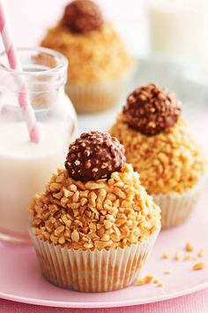 Sweet, fluffy peanut butter cupcakes are topped with a rich, creamy icing and sprinkled with crushed nuts. Topped with a sweet, crunchy hazelnut chocolate, this dessert is wonderfully decadent and perfect for a Christmas treat.