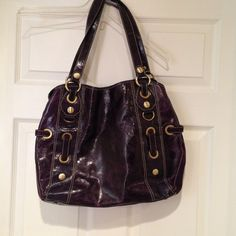 Gorgeous purple leather bag. All leather with suede on the sides and suede strap through some of the hardware. It's about 16 1/2 inches wide and about 13 inches high. Only used a couple of times. Nuovedive  Bags