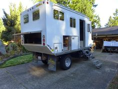 Renovated 2003 Mitsubishi Fuso Off Grid Cruiser © Paul Jensen <> When Paul got the vehicle it was cramped and outdated. He stripped it down and made it into a refreshing, fully self contained, off grid cruiser.