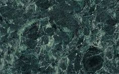 Dark Green marble features a dark green and black pattern with light veins. It is recommended for interior projects including flooring, countertops and walls.