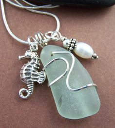 Genuine surf tumbled sea glass is hand wire wrapped in sterling silver to create a pretty one of a kind pendant. A sterling silver sea horse Seashell Jewelry, Sea Glass Jewelry, Beach Jewelry, Stone Jewelry, Metal Jewelry, Jewelry Art, Jewelry Design, I Love Jewelry, Jewelry Making