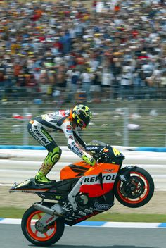 Celebrate it like a Rossi! Valentino Rossi Repsol Honda 990cc Spain MotoGP Jerez 2003. After hearing some of the stuff about vale in jorges biography, im kidof disliking Valentino. Sorry but some of the stuff hes said!