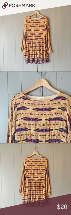 "🌙 Freeway Boho Tribal Print Layered Dress This dress is absolutely adorable and in good used condition. Would look so cute with boots! And it's lightweight enough to be worn in the spring. Has a little stretch. One area of loose threading as shown in last photo. But oh so cute!   Armpit to armpit is 17"" Length is 34""  ✨✨✨ Offers are always welcome ✨✨✨ ✨ OR-click add to bundle and I'll send you a private offer! Freeway Dresses Mini"