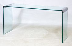 Lot 132: Mid-Century Modern Waterfall Glass Parson Table (in the style of) Leon Rosen for Pace; c.1970, having a glass top and glass legs