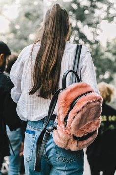 Street Style_ oversized shirt worn with denim and accessorised with faux fur ruck || Saved by Gabby Fincham ||