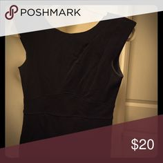 Black Form Fitting Dress Gorgeous Black form fitting dress! Short sleeves- can be dressed for work with a cardigan and boots or for a night out on the town! Length meets 3/4 down one's thigh. Dresses Midi