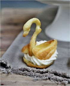 Filled Pate a Choux Swans ... the neck my teen piped out was the prettiest!