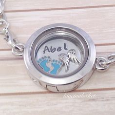 A beautiful floating locket memorial bracelet for the loss of a baby boy. Personalized with the name of the sweet angel baby for mom to keep him close. #babymemorialbracelet #babylossbracelet #babymemorialjewelry #babylossgift #babylossjewelry #babymemorialgify #stillborngift #miscarriagegift #childmemorialgift #memorialfloatinglocket #memorialgift #childlossgift