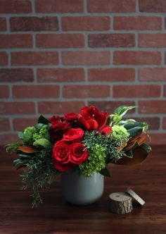 Rich shades of crimson are warm and inviting for the holiday season: 'Crimson Classic' by Winston Flowers.
