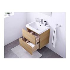"IKEA - GODMORGON / ODENSVIK, Sink cabinet with 2 drawers, white stained oak effect, 23 5/8x19 1/4x25 1/4 "", , 10-year Limited Warranty. Read about the terms in the Limited Warranty brochure.Smooth-running and soft-closing drawers with pull-out stop.You can easily change the size of the box by moving the divider.You can easily see and reach your things because the drawers pull out fully.Drawers made of solid wood, with bottom in scratch-resistant melamine.The included water trap is easy to…"