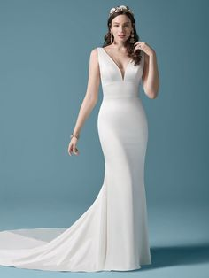 Anissa| A simple v-neck satin sheath wedding dress with plunging scoop back dress and double buttons. #wedding #weddingdress #weddingdresses #bridal #bridalgown #bride #weddingplanning #weddingfashion #maggiesottero