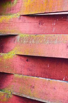 """woven"" barn boards. layers of pink, yellow, orange... beautiful photo."