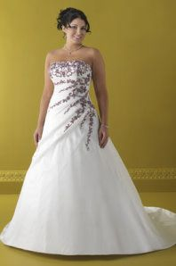 This is a beautifully accented wedding gown designed by Venus Bridals 868037 especially for the plus size figure