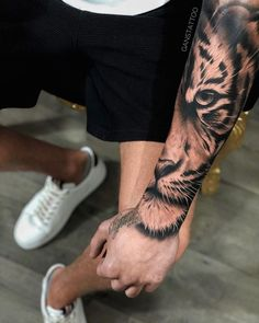Half tiger head tattoo on forearm Tiger Forearm Tattoo, Tiger Eyes Tattoo, Cat Eye Tattoos, Tiger Tattoo Sleeve, Lion Head Tattoos, Forearm Sleeve Tattoos, Best Sleeve Tattoos, New Tattoos, Half Sleeve Tattoos For Guys