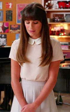"Rachel..  Wore this somber blouse and pleated skirt as she paid tribute to her ""person"" and soulmate, Finn, in ""The Quarterback"" 5x03.  Sang ""Make You Feel My Love"" by Adele."