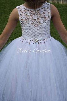 Tutu DressWhite Tutu DressFlower Girl DressLace Tutu Discover recipes, home ideas, style inspiration and other ideas to try.****High Quality Crochet Dresses**** This unique hand crocheted dress features e.It's the time to become exciting and found pe Baby Tulle Dress, Crochet Tutu Dress, Lace Top Dress, Girls Tutu Dresses, White Flower Girl Dresses, Wedding Dresses For Girls, Tutus For Girls, The Dress, Dress Wedding