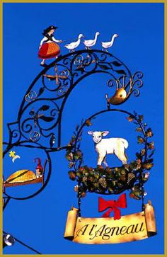 Beautiful wrought iron sign for A l'Agneau Restaurant, Alsace, on the wine route...... ᘡղbᘠ