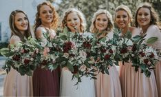 Bride and bridesmaids bouquets that will make your heart happy! For the bride quicksand and blush pink roses, white and burgundy mums and mixed greenery. Burgundy and pink mini carnations, white mums with mixed greenery for the bridesmaids. A combination that will make your dream wedding come to life!
