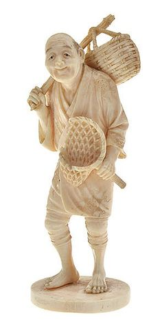 A JAPANESE IVORY OKIMONO OF A FISHERMAN MEIJI PERIOD, 19TH CENTURY some loss to net, signed to base, 14cm high
