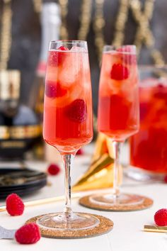 New Year's Eve Champagne Punch is loaded with Triple Sec, blackberry brandy, Chambord, pineapple juice, ginger ale, and champagne for a drink that's sure to impress all your NYE party guests! | Sugar & Soul