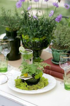 Use tiny potted plants to mark each guest's place, then send them home as favors at the end of the night.