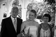 Bride arrives with her mother and father at a wedding at Alberton House, Mt Albert, Auckland. Black and white. BeSo Studios create beguiling fine art family photographs for the walls of the most discerning clients homes. We specialise in wedding and family portrait photography, and supply prints on the highest quality media, framed in beautiful conservation standard frames. We are a high end studio located in the beautiful city of Auckland, New Zealand.