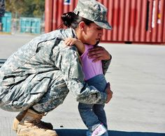 """""""A Mother's Love:"""" A Soldier and Mother embraces her daughter during the Forward Support Company, Battalion, Field Artillery Regiment's Motorpool Olympics as part of Suicide Stand Down Day. Army photo by Maj. Military Women, Military Life, Military Families, Mothers Love, Happy Mothers Day, Real Life Heros, Army Family, Military Homecoming, American Veterans"""