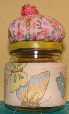 Pin cushion made out of a baby food jar