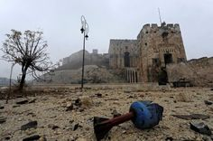 2016 in review: 50 powerful photos of war in Syria, Iraq, Libya and Yemen:      13 December 2016: The remains of a shell are pictured outside Aleppo's historic citadelOmar Sanadiki/Reuters