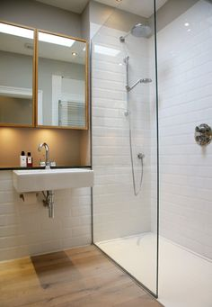 Shower Room - Fixed glass panel and shower tray set flush with floor Loft Bathroom, Downstairs Bathroom, Bathroom Flooring, Modern Bathroom, Warm Bathroom, Wood Floor Bathroom, Shower Wood Floor, Loft Ensuite, Rain Shower Bathroom