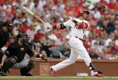 St. Louis Cardinals' Carlos Beltran (3) hits a three-run home run against the Pittsburgh Pirates in the third inning of Game 1 of baseball's National League division series on Thursday, Oct. 3, 2013, in St. Louis. Catching for the Pirates is Russell Martin. (AP Photo/Jeff Roberson)