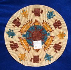 """A finely woven large 13x2"""" basket. Useful for fruit or party snacks.. but SO pretty, you may just want to hang it on your wall as a decorative accent piece! $24.95 #basket #handmade #southwestern"""