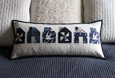 cute pillow, with these little houses. The format and color scheme are pleasing as well.