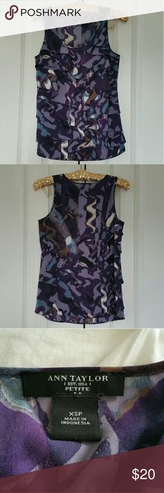 """Ann Taylor Purple Ruffle Front Sleeveless Blouse Excellent condition  Size is XS Petite.  100% polyester.  Measures 17"""" across the bust and 24"""" length. Colors are purple, blue, white, brown, and beige.  No trades. If you have any questions please ask. If you don't like the price please use the offer button.  Have an amazing day! """"Great Sense of Style"""" Ann Taylor Tops Blouses"""