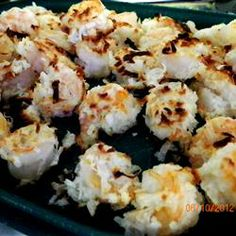 Baked Coconut Shrimp - YUM  Made these for Christmas and they were amazing!  Dipping sauce suggested by readers was great:  1/2 c orange marmalade, 2 t stone ground mustard, 1 t horseradish--big hit!