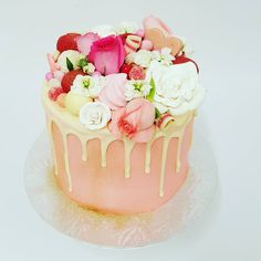 Smooth Pink with gold glitter and white chocolate drip and overload toppings