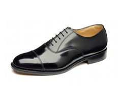 Model number '747'  is an absolute classic English style, a black polished toe cap oxford shoe that is suitable for all formal occasions. It features a traditional rounded toe shape, and is made in a medium width (F) fitting. This shoe is made in England.