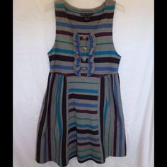 """MARC BY MARC JACOBS Gray Striped Tank Dress Size L JUST REDUCED From former Louis Vuitton designer MARC Jacobs's second line comes this cute gray summer tank dress. Features include:   Made of a heavy soft knit cotton Multicolored stripes Pull-on style Ruffle detail with buttons on front Two front slash pockets Hits above the knee  In very good pre-owned condition with no major issues of note  MEASUREMENTS: 34"""" chest, 36"""" waist, 50"""" hips, 37"""" length Marc by Marc Jacobs Dresses"""