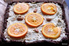 raw nuts orange cake with some cocoa; bottom: almonds, pumpkin seeds, dates, cocoa; top: cashews, orange peel