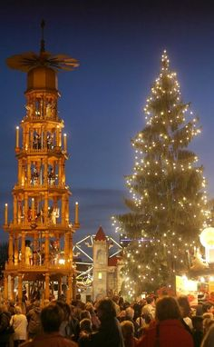 Christmas in Dresden, Germany...I love the wooden carousel on the left of the Christmas tree.  I have a small version of that.  The candles burning on the base make the windmill on the top go around.
