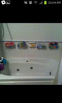 Shower rod & hanging baskets.. great way to keep bath & shower organized