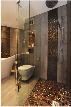 Pennies as a shower floor has to be pretty high on the list of stupid ideas. I love penny tile. Actual pennies? Not so much. What is Pinterest's deal with using junk as floor or wall treatments?