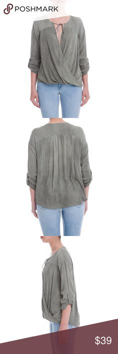 Surplice Neck Top Skinny ties frame the femme surplice neckline of this gauzy lightweight top with cute roll tab sleeves. 100% viscose. Semi-sheer. Lush Tops Blouses