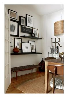 Love the mix of frames on walls and frames on ledges!