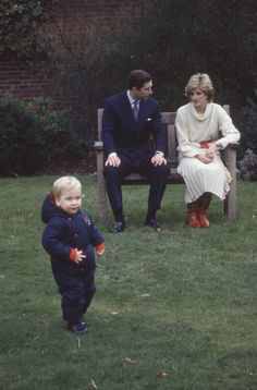 Princess Diana and her husband, Prince Charles, watch as a toddler Prince William explores the gardens of Kensington Palace.