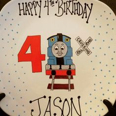 """Personalized ceramic plates """"thomas the train 4th birthday plate"""" Can personalize plates, mugs, wine glasses, bowls, ornaments etc! Check out my fb page michelle's Personalized creations or my instagram michellespersonalizedcreations With more of my work! Plates are $27.99 free shipping anywhere in us! ☺ Birthday Plate, 4th Birthday, Personalized Plates, Thomas The Train, Fb Page, My Fb, Ceramic Plates, Bowls, Ceramics"""
