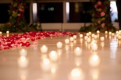 NYC Proposal Photos by Mikkel Paige Photography. Candlelight rose aisle at Trump Soho overlooking NYC skyline. Carpet of candles and rose petals! #mikkelpaige #proposals #willyoumarryme #nycskyline #nyc #soho #candlelight #candles #rosepetals