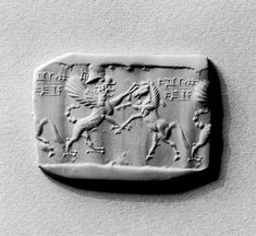 Sumerian Cylinder Seal with Human-Headed Griffin Attacking a Horse. Walters