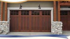 Clopay Reserve Collection Wood carriage house style overhead garage door.