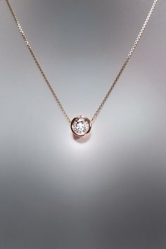 Black, solitaire and floating single diamond necklace designs, pendants and sets. Different cross, heart and initial diamond necklaces and designs. Single Diamond Necklace, Diamond Solitaire Necklace, Diamond Jewelry, Diamond Necklaces, Diamond Heart, Diamond Choker, Pearl Necklace, Gold Necklace Simple, Gold Jewelry Simple